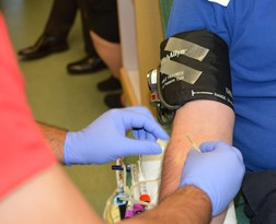 Clear AK phlebotomist taking blood sample